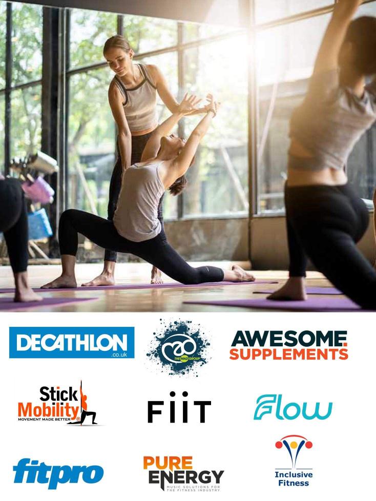 Yoga teacher correcting technique