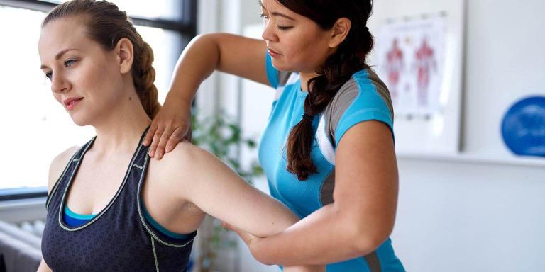 woman massaging girls neck