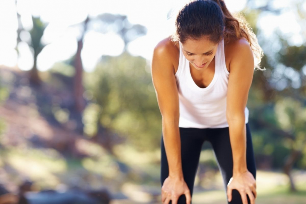 Woman out of breath from exercise