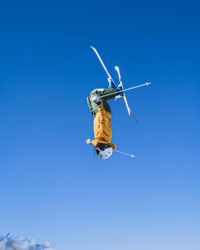 Backflip mogul skiing.